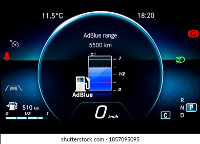 Close up of AdBlue level indicator on illuminated car dashboard. Car instrument panel with speedometer, fuel gauge and seat belt reminder. Urea level display on car cluster. Check diesel exhaust fluid