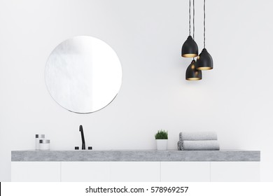 Close up of a bathroom sink, a round mirror and a towel. There is a marble decoration element. Concept of modern luxury interior. 3d rendering. Mock up.