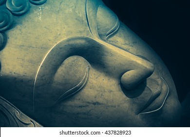 Close up beautiful sleeping Buddha face with painting art effect.