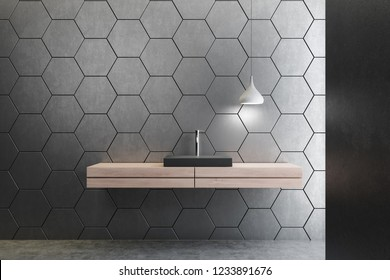 Close up of black bathroom sink standing on wooden countertop in room with gray honeycomb pattern walls. 3d rendering