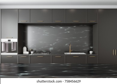 Close up of black marble countertops and black cupboards with built in appliances. A black marble table in the foreground. 3d rendering mock up