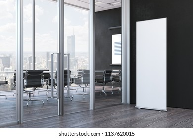 Close up of blank white roll up next to meeting room in modern office with black walls and large windows, 3d rendering
