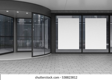 Close up of a corporate building entrance with a glass door and two large vertical posters in the windows. 3d rendering. Mock up.