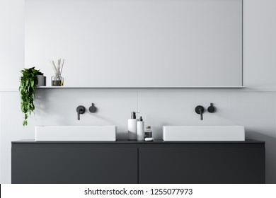 Close up of double bathroom sink standing on gray countertop in room with white walls with a big horizontal mirror above it. 3d rendering