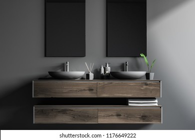 Close up of double sink standing on a wooden vanity unit in a grey wall bathroom with two vertical mirrors. Relaxation and self care concept. 3d rendering