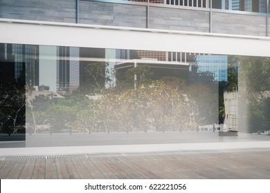 Close up of empty glass storefront in daylight. Advertisement concept. Mock up, 3D Rendering