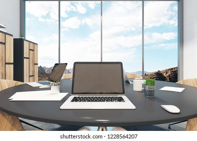 Close up of empty laptop in modern meeting room interior with sky view. Mock up, 3D Rendering