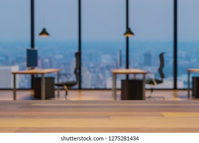 Close up of an empty wooden table, blurry colorful modern office interior background, copy space, 3D Illustration