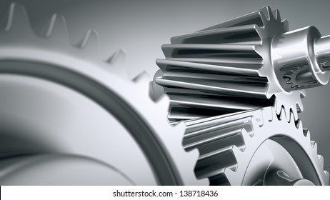 Close up of a group of interlocking stainless steel gears.