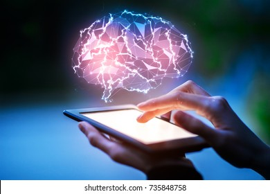 Close up of hands using tablet with glowing polygonal brain on blurry blue background. Communication concept