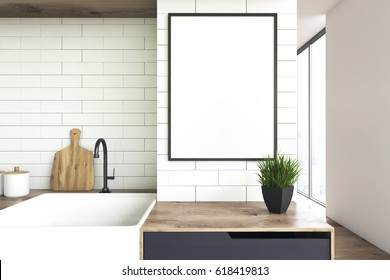 Close up of a kitchen sink and a wooden countertop with a flower pot standing on it. There is a framed vertical poster above it. 3d rendering, mock up