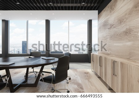 Close Up Of A Light Wooden Wall Decoration And Large Round Meeting Room Table