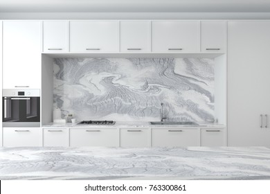 Close up of marble countertops and white cupboards with built in appliances. A marble table in the foreground. 3d rendering mock up