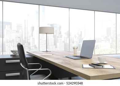 Close up of a massive CEO table made of wood with a laptop on it. Panoramic windows. 3d rendering. Mock up