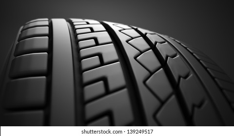 Close up on a tire on a dark background.