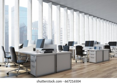 Close up of an open space office interior with a wooden floor, a panoramic window with shades, rows of computer tables and office chairs. 3d rendering mock up