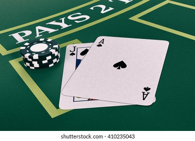 close up view of a blackjack table with cards and fiches (3d render)