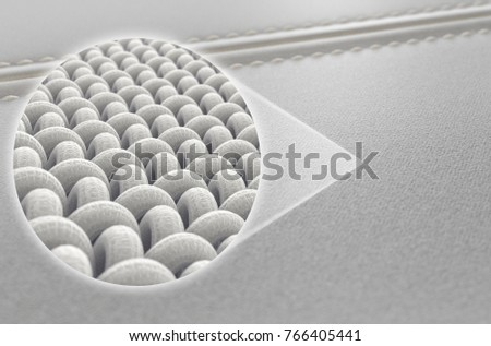 A close up view of two sections of a white canvas fabric stitched together and a microscopic zoomed insert showing the intrictae fabric weave pattern - 3D render