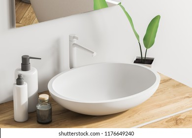 Close up of white sink standing on a wooden vanity unit in a white wall bathroom with a mirror and liquid soap. Relaxation and self care concept. 3d rendering