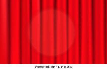 Closed red theater curtain with spotlight in the center