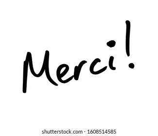 Close-up of a Merci! message handwritten on a whiteboard.  Merci is the French word for Thanks.