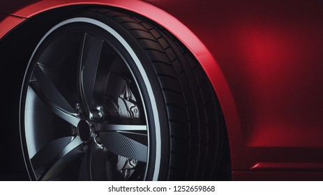 Close-up of a modern luxury car wheels. Red Car. 3d rendering and illustration.