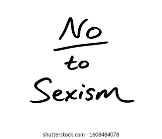 Close-up of a No to Sexism message handwritten on a whiteboard.