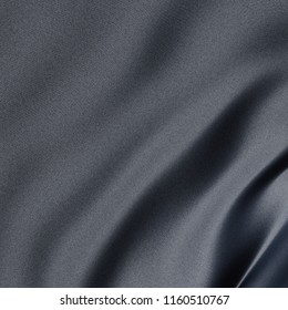 Close-up on a synthetic gray sheet with slightly blue reflection. 3d illustration
