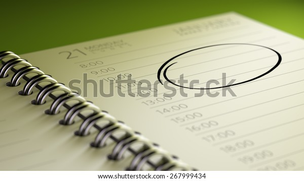 Closeup of a personal agenda, organizer or planner, setting an important date, marking a day of the month representing a organizing time and schedule.
