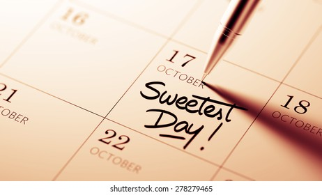 Closeup of a personal agenda setting an important date written with pen. The words Sweetest Day written on a white notebook to remind you an important appointment.