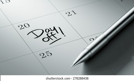 Closeup of a personal agenda setting an important date written with pen. The words Day off written on a white notebook to remind you an important appointment.