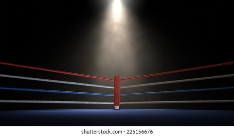 A closeup of the red corner of a regular boxing ring surrounded by ropes spotlit by a spotlight on an isolated dark background