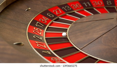A closeup of a regular wooden roulette wheel with red and black markers and gold detail on an isolated background - 3D render