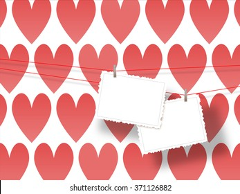 Close-up of two hanged postcards on red hearts illustration background