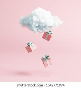 Nuage avec coffret cadeau, pluie sur fond rose pastel. Une idée créative.Concept minimal. Rendu 3d