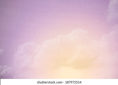 cloudscape on grunge paper texture ,yellow to purple color