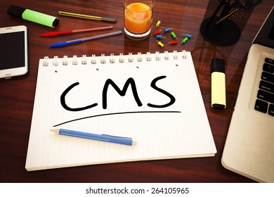 CMS - Content Management System - handwritten text in a notebook on a desk - 3d render illustration.