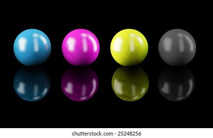 CMYK colors: set of shiny balls isolated on black