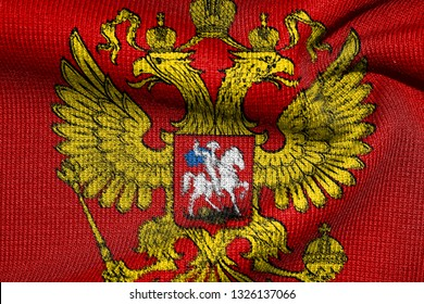 Coat of arms of Russia on a sweater. Eagle close-up. Symbol, emblem of the Russian Federation. Texture, background.