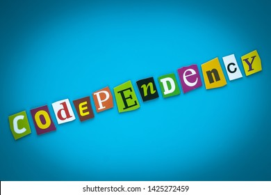 Codependency - word on blue background from colorful letters. Abstract card with an inscription. Text, headline, caption, heading on banner. Letter on bright illustration. Psychologic concept.
