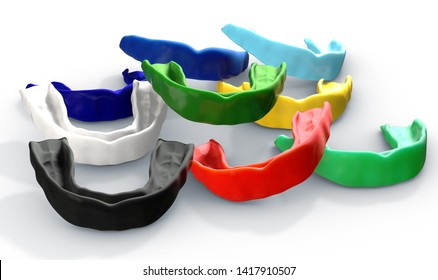 A collection of colorful regular moulded sports gum guards on an isolated background - 3D render