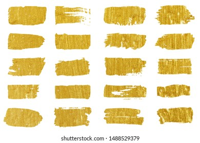 Collection of golden paint strokes. Grunge abstract hand painted element gold strokes with a brush.