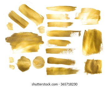 Collection of golden paint strokes to make a background for your design