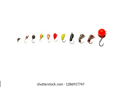 Collection of winter fishing jig. From small to large. Isolated on white background. Illustrative editorial.