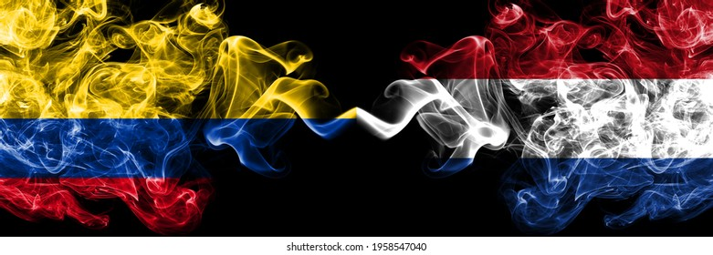 Colombia, Colombian vs Netherlands, Dutch, Holland smoky mystic flags placed side by side. Thick colored silky abstract smokes flags.
