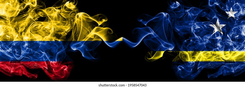 Colombia, Colombian vs Netherlands, Dutch, Holland, Curacao smoky mystic flags placed side by side. Thick colored silky abstract smokes flags.