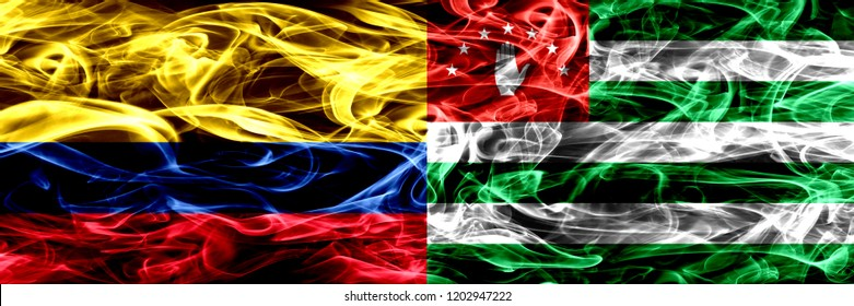 Colombia vs Abkhazia, Abkhazian smoke flags placed side by side. Thick colored silky smoke flags of Colombian and Abkhazia, Abkhazian