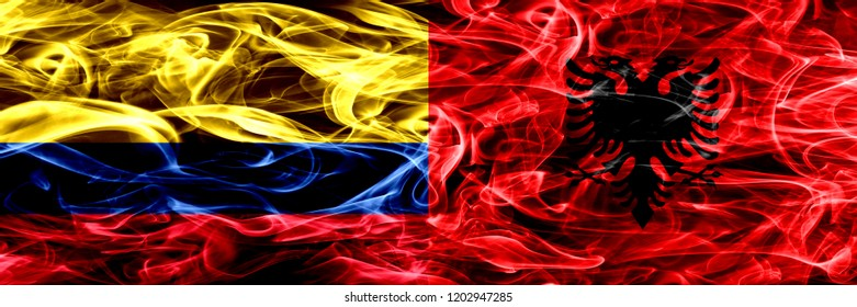 Colombia vs Albania, Albanian smoke flags placed side by side. Thick colored silky smoke flags of Colombian and Albania, Albanian