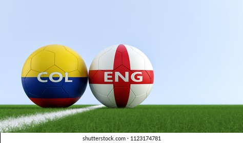 Colombia vs. England Soccer Match - Soccer balls in Colombia and England national colors on a soccer field. Copy space on the right side - 3D Rendering