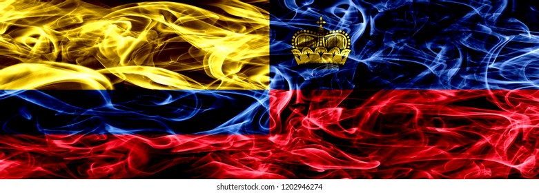 Colombia vs Liechtenstein, Liechtensteins smoke flags placed side by side. Thick colored silky smoke flags of Colombian and Liechtenstein, Liechtensteins